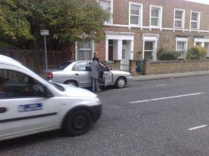 man urinating beside car